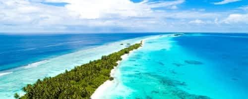 a stretch of beach in the maldives