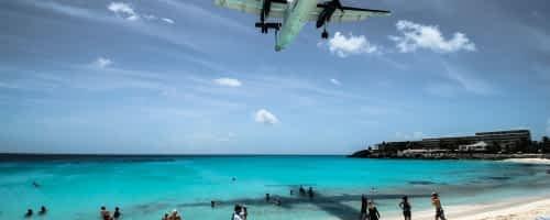 plane over beach in st martin